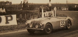 <h5>NOJ393 at Le Mans 1953</h5><p>NOJ391 (in reality 393) during the race. The fog lamps are now in front of the grill instead of the position at scrutineering. The number 33 on the door panel obviously is at a different hight other than at scrutineering. The number plate 391 on the front is missing because it was wrinkled during the crash.</p>